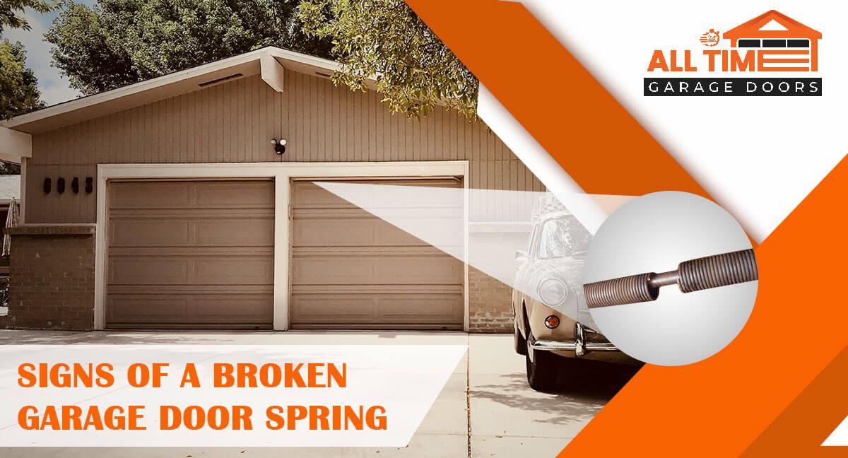 signs of a broken garage door spring
